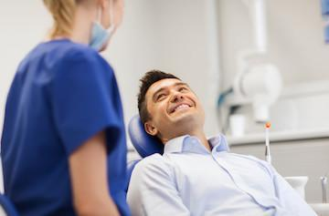 man smiling in dental chair | dentist west chester oh