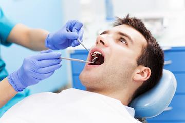 man during periodontal treatment exam in west chester