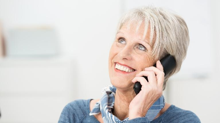 Dentures in West Chester OH | Older Woman on the Phone