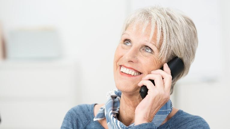 Woman on Phone | Dental Implants in West Chester OH