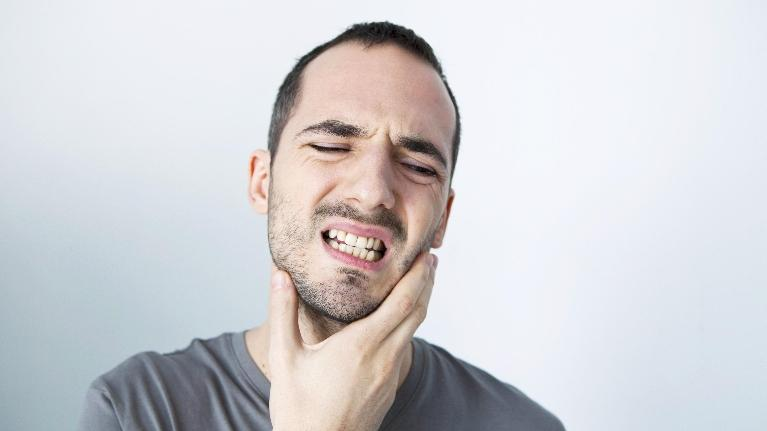 Man Holding Mouth in Pain | Dental Emergency Care in West Chester